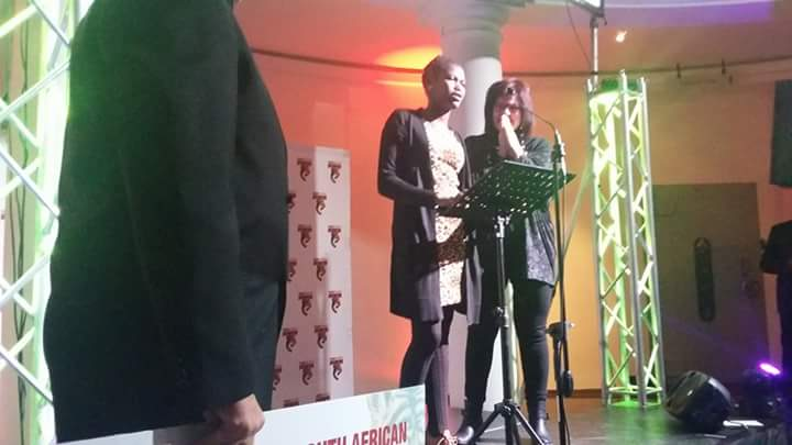 Phumza Holland giving her 'Winning speech' while her Hospitality lecturer Me Hilda Enslin is standing next to her.